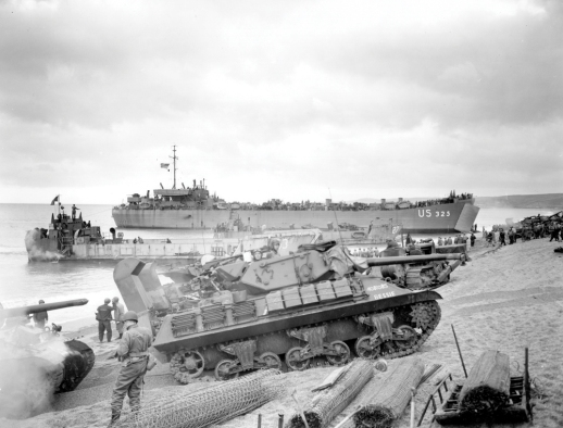M10 Wolverine tank destroyer lands on Normandy Beach with LST 325 in background