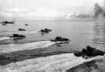 As a rocket-firing LCI lays down a barrage on the already obscured beach on Peleliu, a wave of Alligators (LVTs, or Landing Vehicle Tracked) churn toward the defenses of the strategic island September 15, 1944. The amphibious tanks with turret-housed cannons went in in after heavy air and sea bombardment. Army and Marine assault units stormed ashore on Peleliu on September 15, and it was announced that organized resistance was almost entirely ended on September 27. (AP Photo)